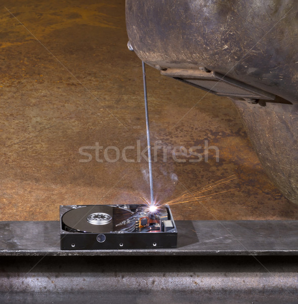 welding a hard disk Stock photo © prill