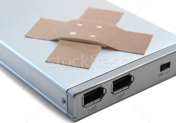 portable hard disc and adhesive plastrer Stock photo © prill