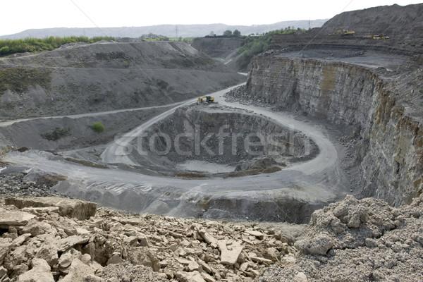 quarry diggers and dump trucks Stock photo © prill