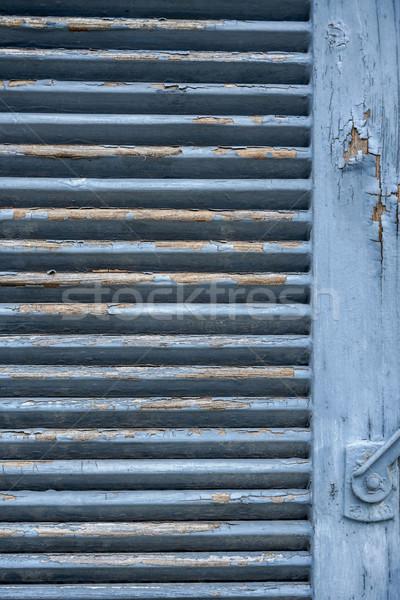 rundown blue shutter Stock photo © prill
