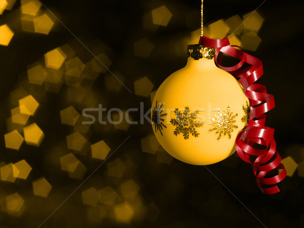 Stock photo: Christmas bauble in blurry back