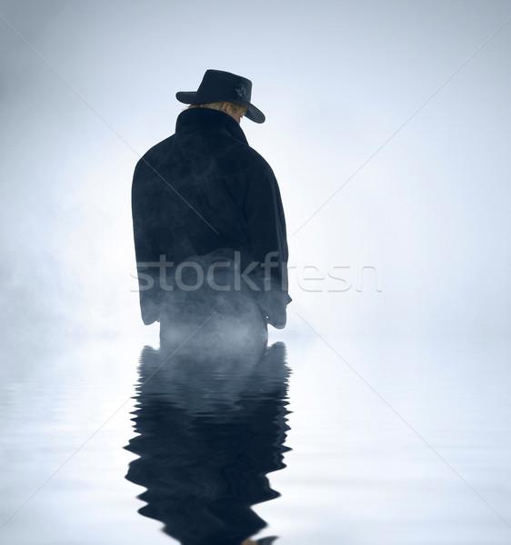 Osoby okop płaszcz stałego wody Zdjęcia stock © prill