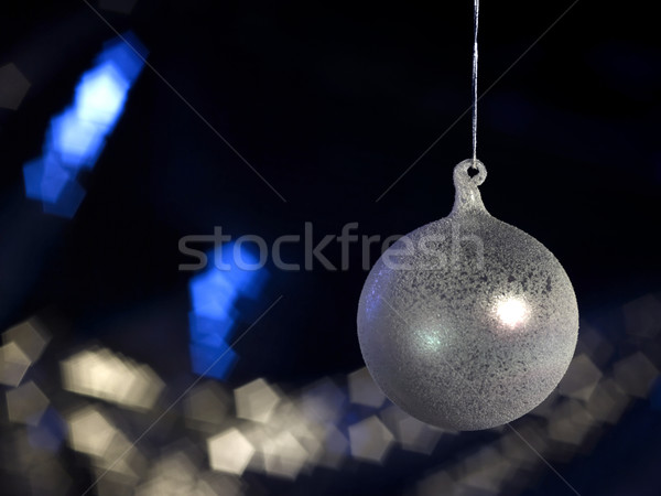 Stock photo: translucent Christmas bauble in dark back