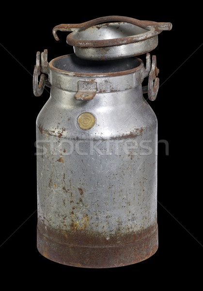 rusty nostalgic milk can Stock photo © prill