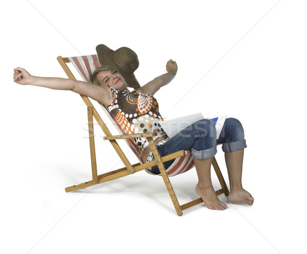 cute girl sprawling in a canvas chair Stock photo © prill