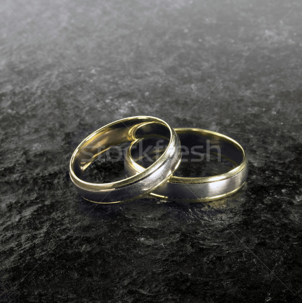 two golden wedding rings on stone surface Stock photo © prill