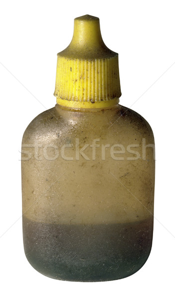dirty old oil bottle with yellow cap Stock photo © prill