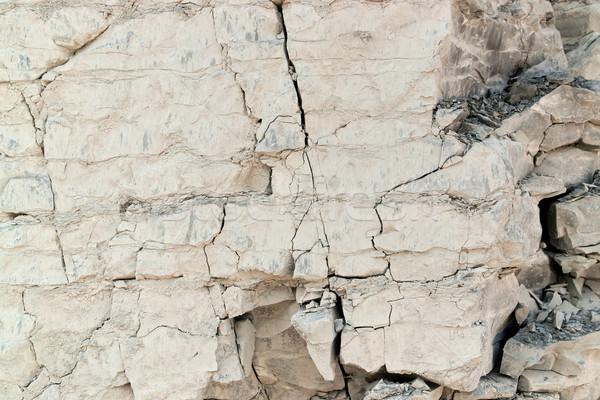 Gebarsten rock gezicht full frame licht bruin Stockfoto © prill