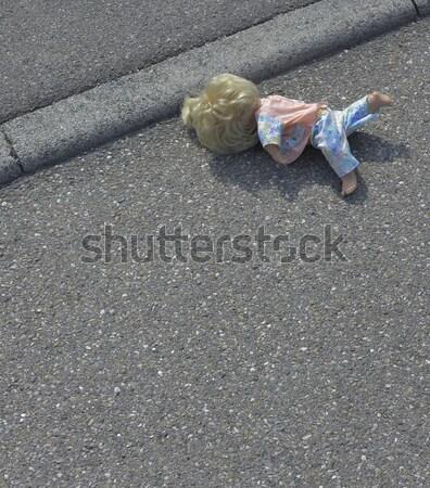 Puppe Straße Lügen Straße Oberfläche sonnig Stock foto © prill