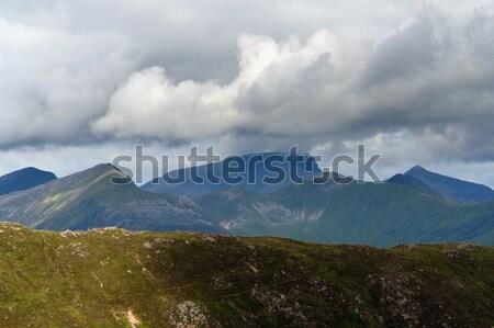 Dramatyczny chmury górskich Szkocji niebo trawy Zdjęcia stock © prill