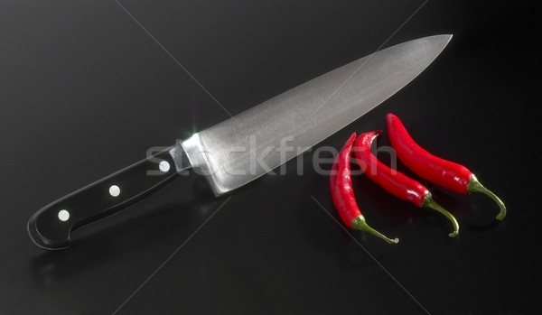 kitchen knife and chillies Stock photo © prill