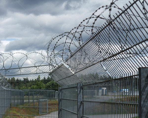 safety fence and dramatic sky Stock photo © prill