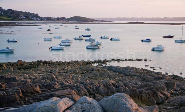 Gün batımı pembe granit sahil pastoral tekneler Stok fotoğraf © prill