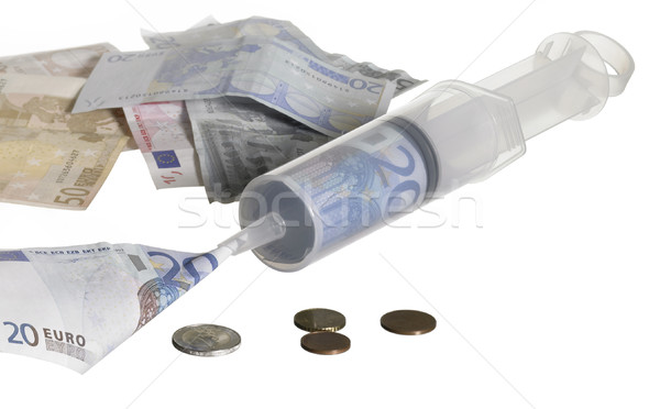 syringe filled with money Stock photo © prill