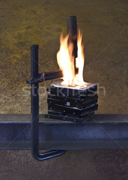 burning vise and hard disks Stock photo © prill
