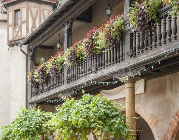 Fából készült erkély részlet virág napos Franciaország Stock fotó © prill