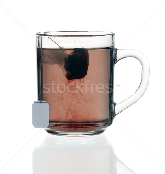 Glas theekopje thee zak transparant vloeistof Stockfoto © prill