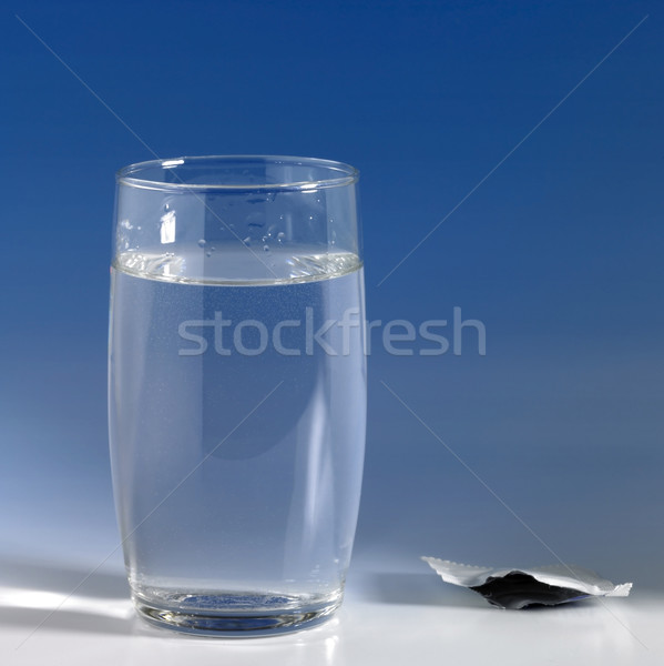 glass of water in blue back Stock photo © prill