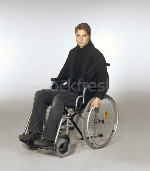 woman sitting in a wheelchair Stock photo © prill