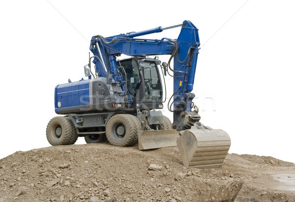 blue digger on earth pile Stock photo © prill