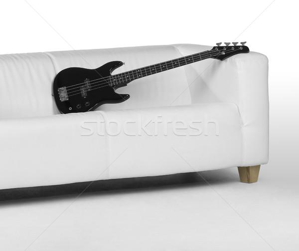 Fekete basszus gitár fehér kanapé fény Stock fotó © prill