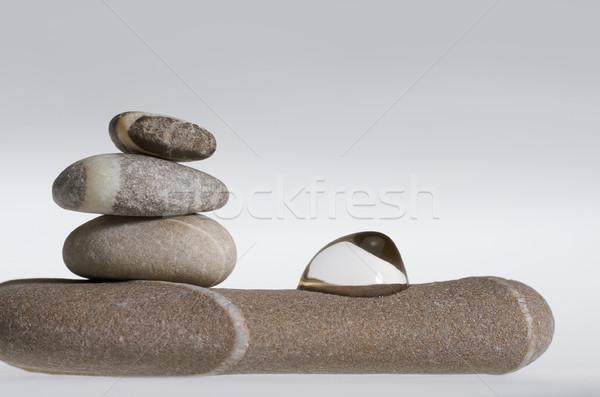 Egymásra pakolva kő kavics egyezség folyadék csepp Stock fotó © prill