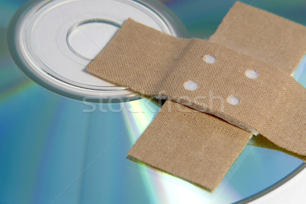 adhesive plaster and CD ROM detail Stock photo © prill