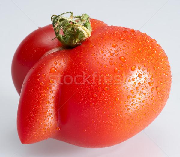 Estranho molhado tomates vermelho luz Foto stock © prill