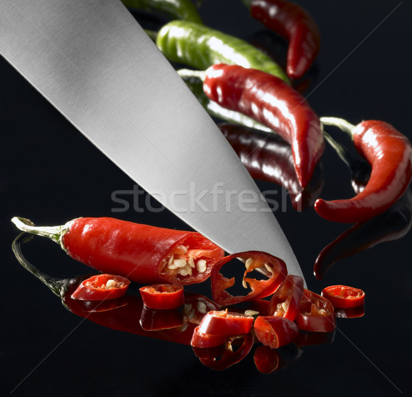 chillies and kitchen knife Stock photo © prill
