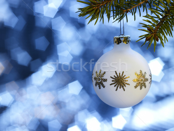 Stock photo: white Christmas bauble in blue back