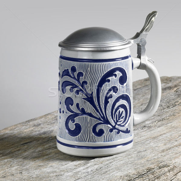 blue decorated stein on wooden surface Stock photo © prill