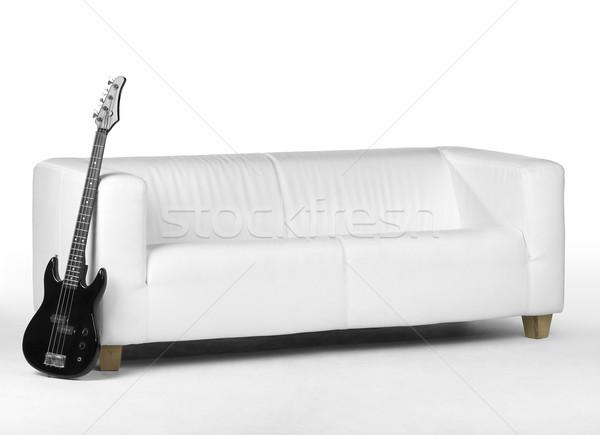 Siyah bas gitar beyaz kanepe geri Stok fotoğraf © prill