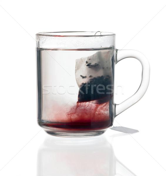 Vetro tazza da tè tè bag trasparente fluido Foto d'archivio © prill