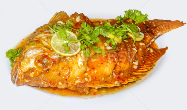 Előkészített tengeri hal edény hal citrom tányér Stock fotó © prill