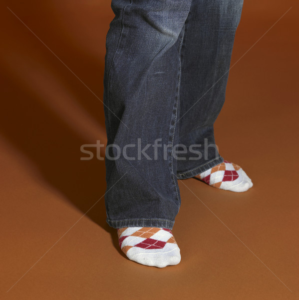 Stock photo: standing feet in brown back
