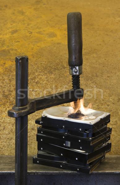 burning vise and hard disks Stock photo © prill