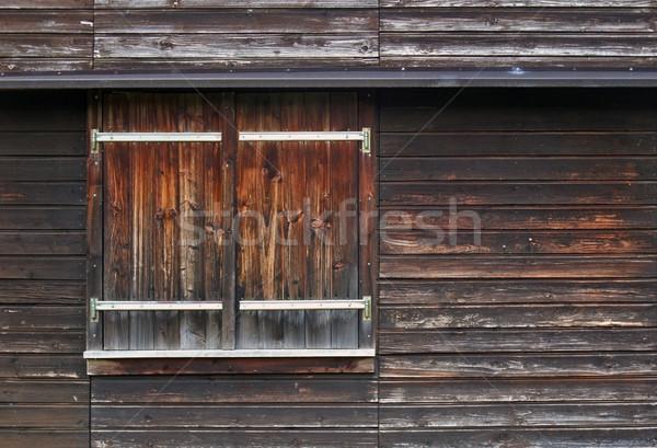 wooden facade with shutter Stock photo © prill