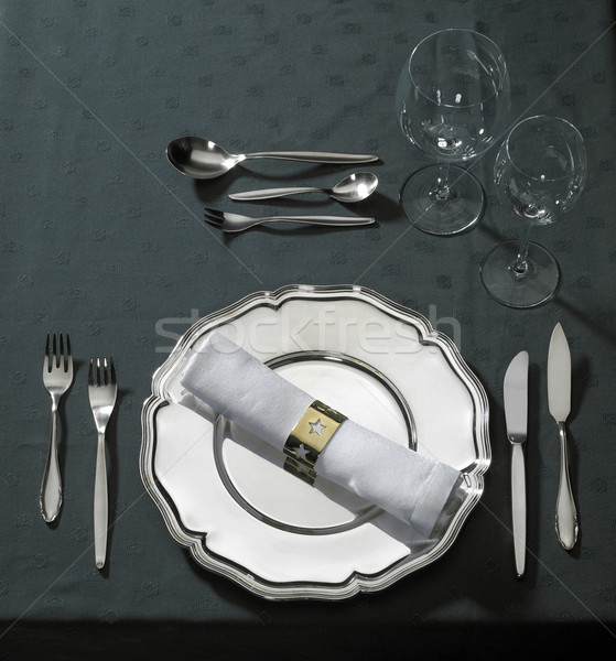 feastful place setting on green tablecloth Stock photo © prill