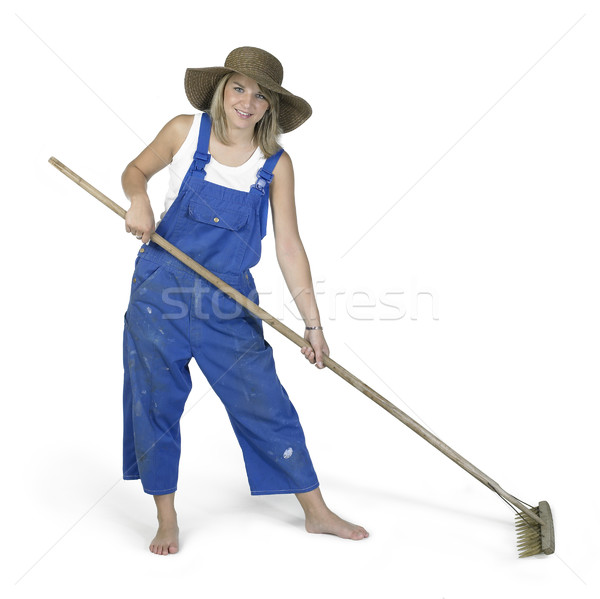 cute girl dressed in workwear while raking Stock photo © prill