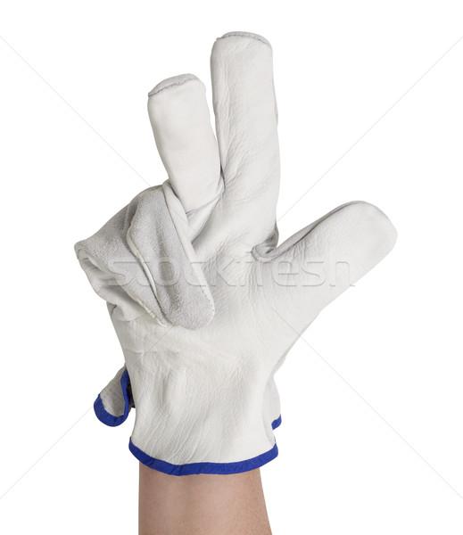 signaling gloved hand Stock photo © prill