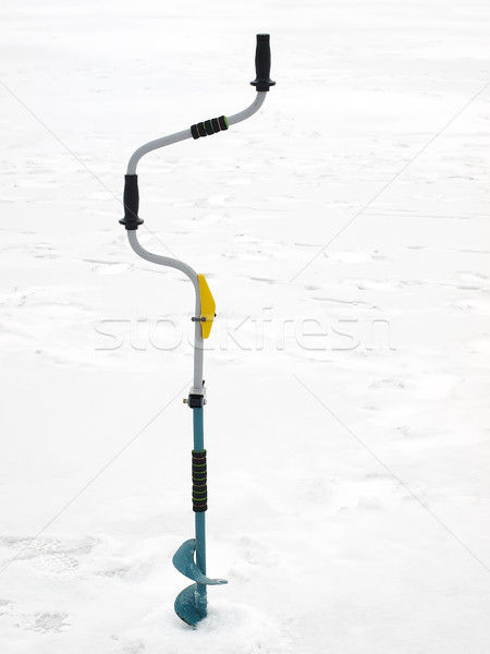 Small hand operated ice auger used in ice fishing Stock photo © Pruser