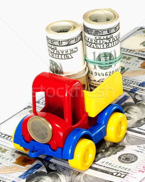 Truck toy on the road from money Stock photo © Pruser