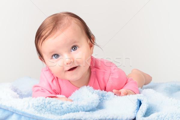 Adorável sorridente menina pequeno estômago azul Foto stock © przemekklos