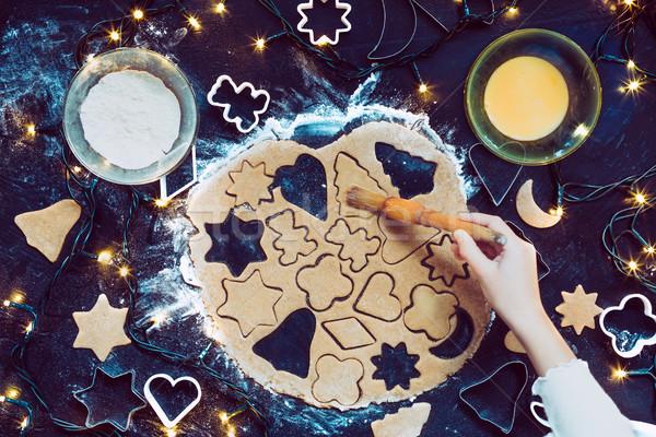 Dziewczyna christmas cookie strony świetle Zdjęcia stock © przemekklos
