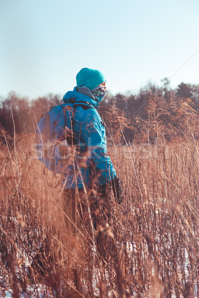 Boy hiking through meadows in the wintertime Stock photo © przemekklos