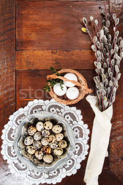 Easter composition of catkins and eggs on wooden table Stock photo © przemekklos
