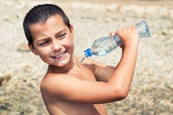Menino verão garrafa jovem Foto stock © przemekklos