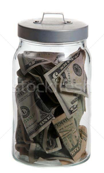 Tároló üveg dollár jegyzetek fehér pénzügy Stock fotó © pterwort
