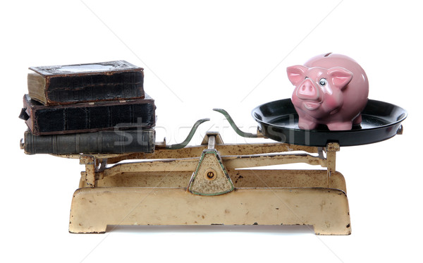 books and piggy bank on scale Stock photo © pterwort