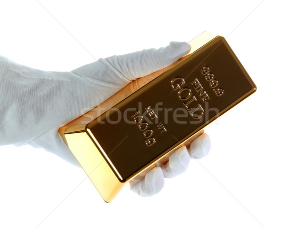 gold bar in hand with white glove Stock photo © pterwort
